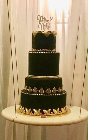 Black wedding cake with gold