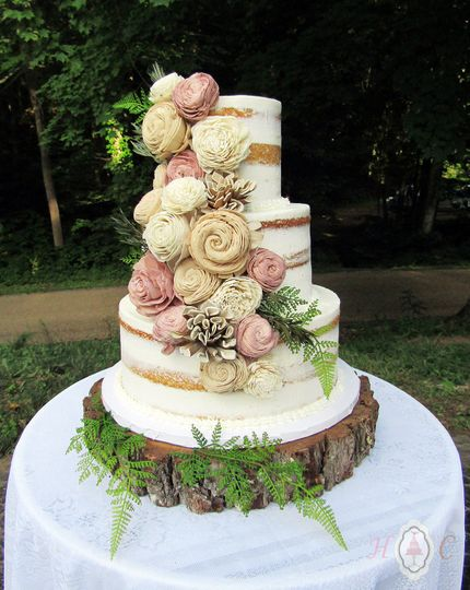 wood flowers on partially naked wedding cake b 120