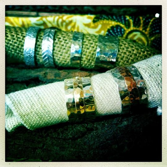 These hammered rings made in 14k gold and sterling silver as well as copper and sterling silver are...