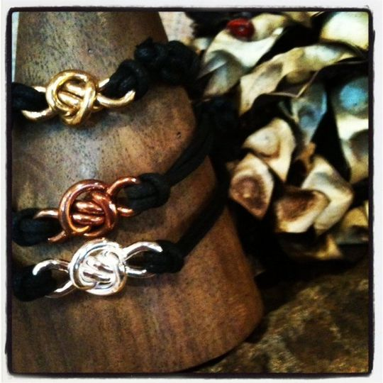 Crucian Knot cord bracelets (from top to bottom) Brass, Copper, and Silver. These cord bracelets...
