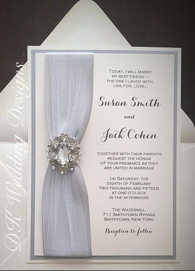 White invitation with silver border and ribbon