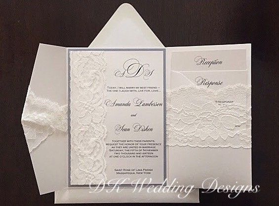 White invitation with blue borders and lace