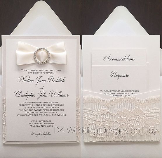 White invitation with ribbon and lace