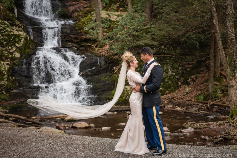 Bride, groom and waterfall