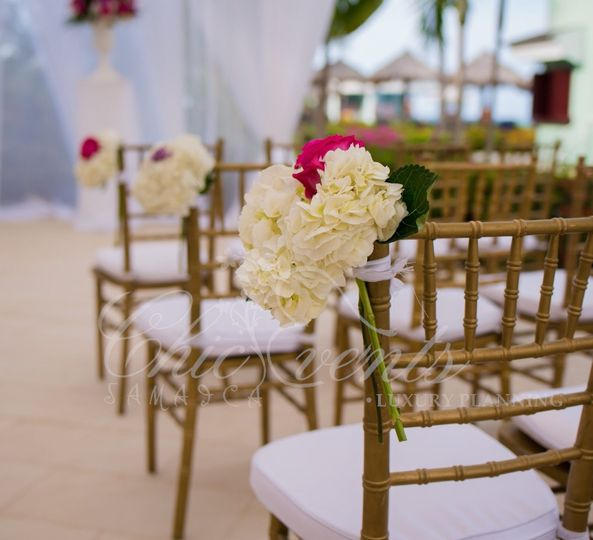Aisle marker of white hydrangeas and fuschia roses