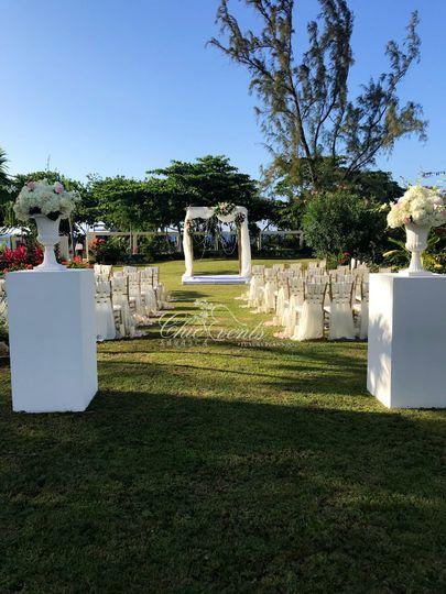 All white wedding ceremony decor - Garden wedding setting