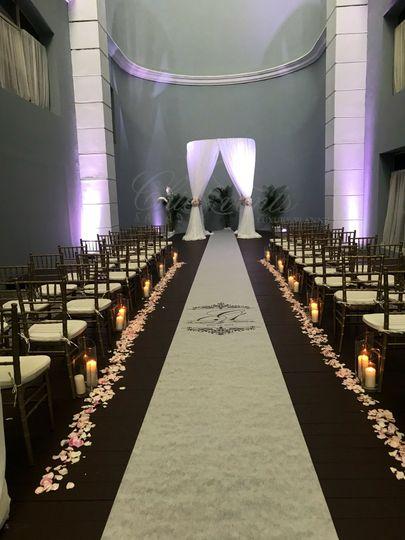 Dome @ Iberostar Grand wedding ceremony decor with candles along aisle