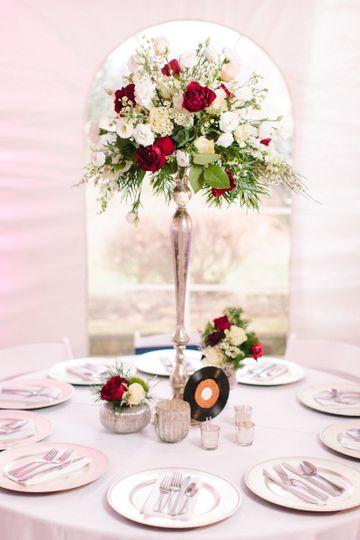 Tall centerpiece flower arrangement   Photo by JOPHOTO