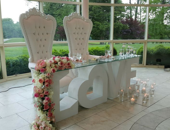High backed chairs and drama to this head table