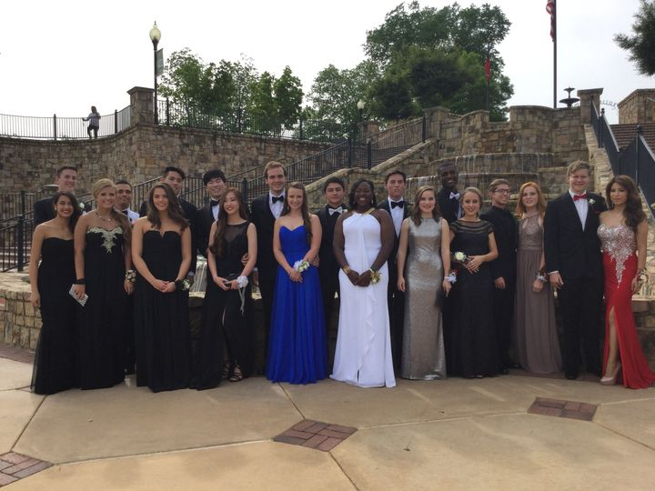 The couple with their groomsmen and bridesmaids