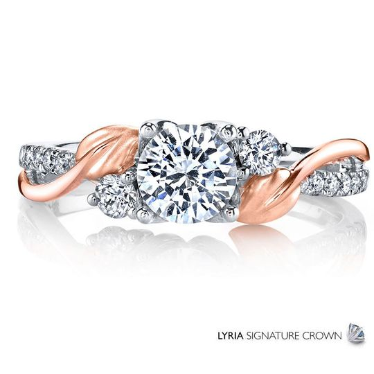 Intertwined satin finished leaves and bands of sparkling white diamonds climb towards a brilliant...