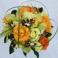 Contemporary, Tropical Rose Mixed Bridal Bouquets are our specialty.