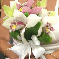 Romantic Cymbidium Orchid Bouquet compliments all shapes and sizes.