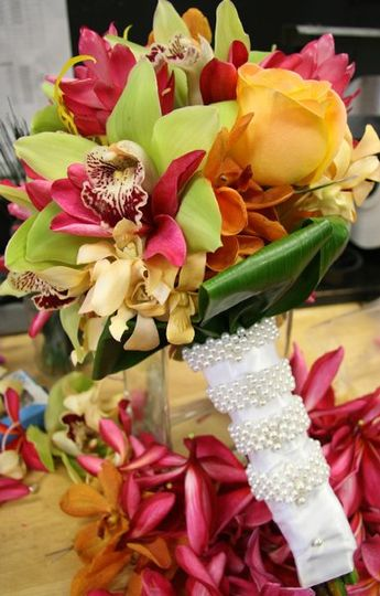 Hand-tied Tropical Orchid Assorted Bouquets can be designed to inspire any color palette.