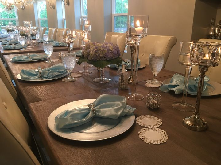 Long table with glasses and plates