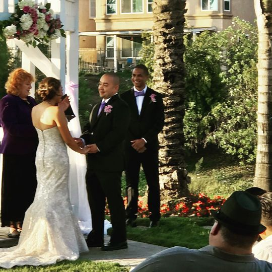 A fun wedding with a custom love story at a lovely country club in Fontana.