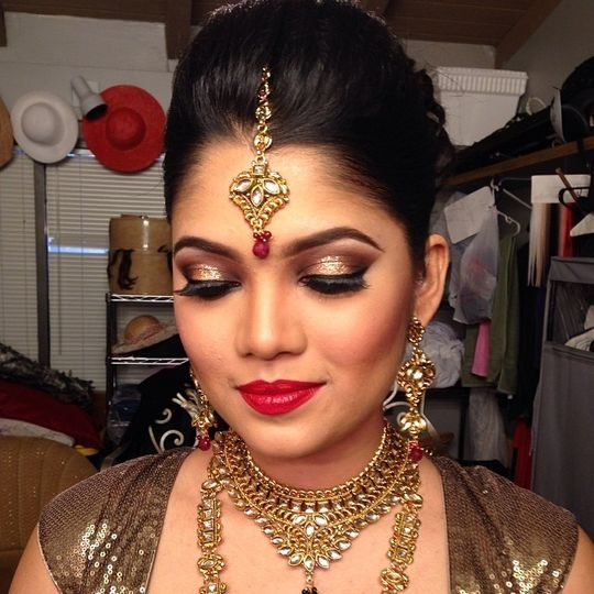 Gorgeous gold eye shadow and red lips