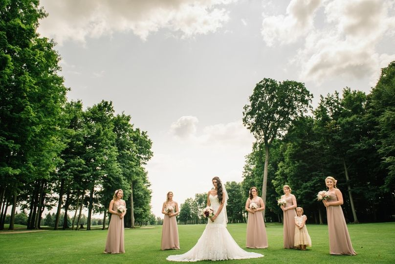 The bride and her bridesmaids portrait on the golf course