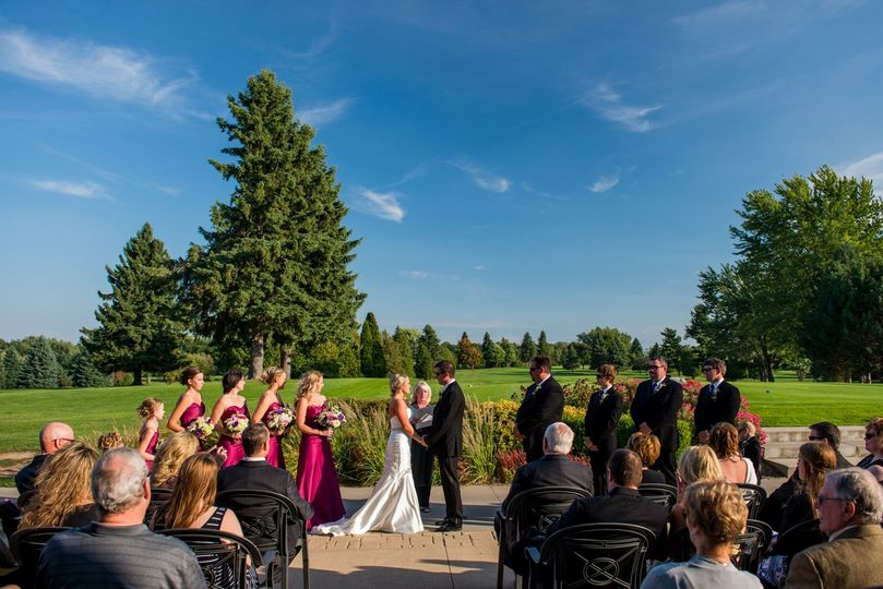 Outdoor wedding ceremony golf course backdrop