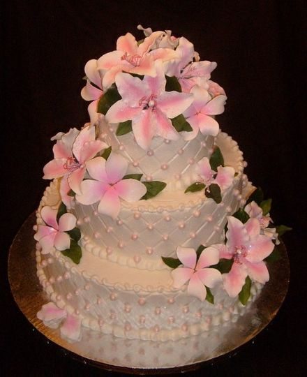 Vanilla cake, raspberry filling with almond buttercream icing. Pink pearls adorn this simple but...