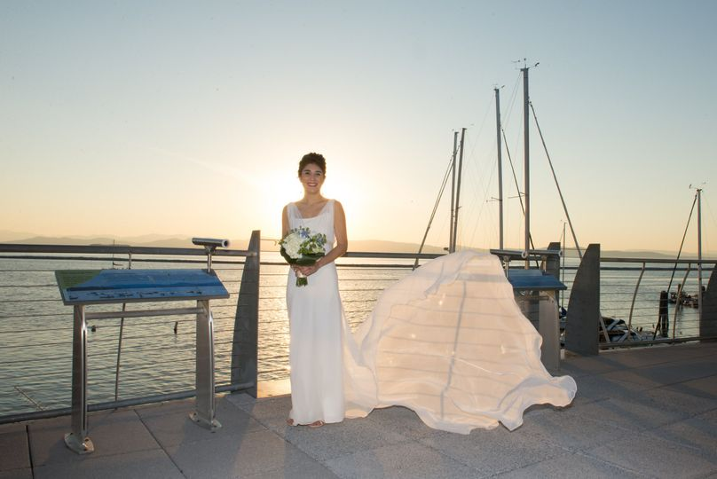 Bride on the dock | Barrie Fisher Photographers