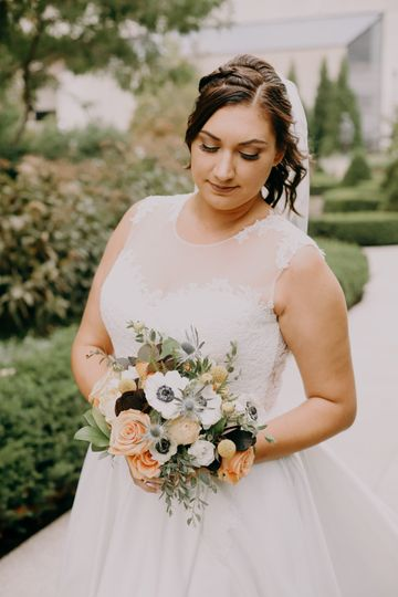 Blush roses and blue thistle