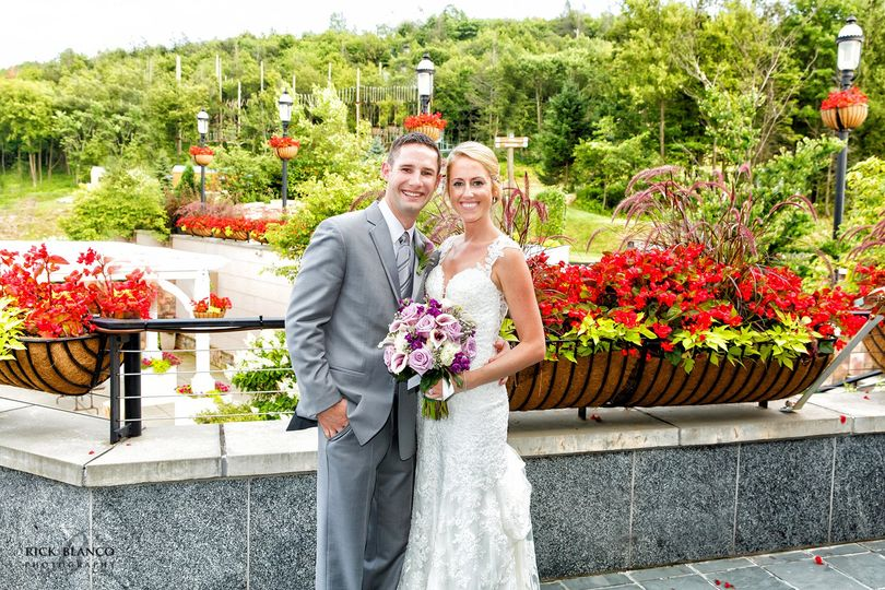 bride and groom overlooking patio at blue mountain