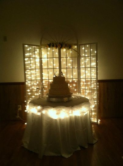 Lighted cake table and backdrop