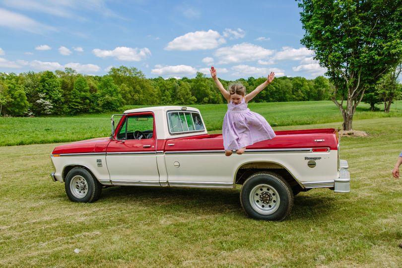 Little girl jumps off the truck