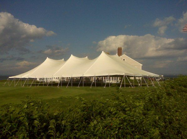 This photo is one of our large tents on a beautiful golf course for a premier event!
