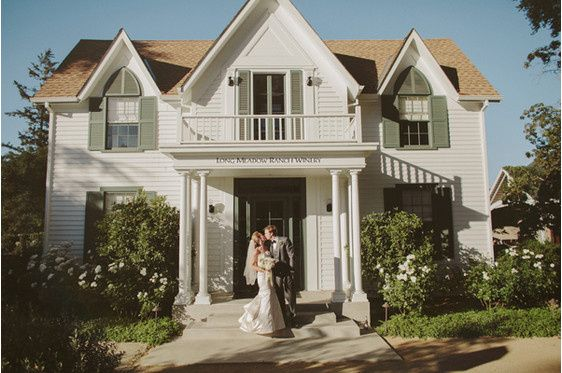 Couple's portrait in front of old victorian farm house