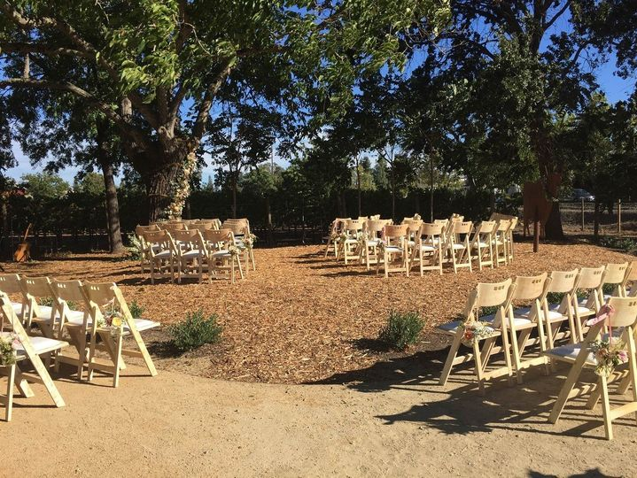 Walnut Tree ceremony area with vineyard backdrop