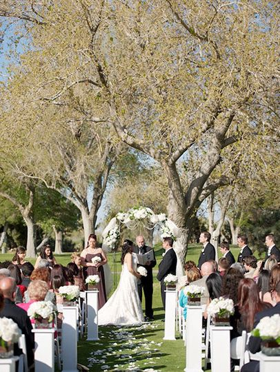 Outdoor Spring ceremony under the trees.