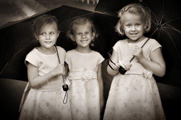 Three Flower Girls in the Rain.