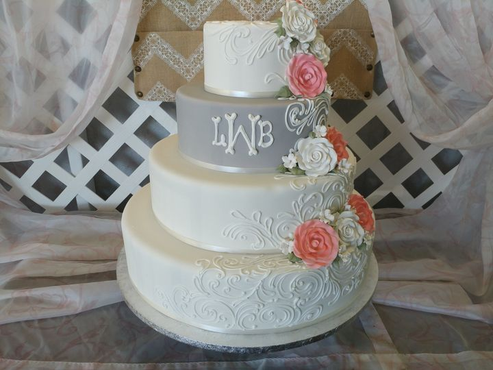 Timeless and true - buttercream scrolls, bold gumpaste roses, and monogrammed initials.
