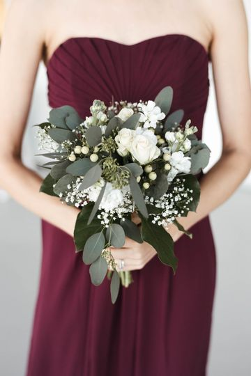 Bridesmaid with white bouquet