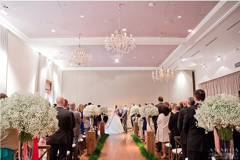 Indoor ceremony with air wall backdrop (Florals by Fleur, Planning by Jayne Weddings & Events) Photo...