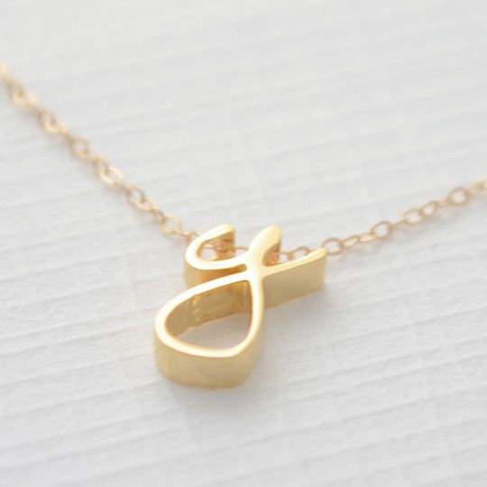 Lowercase Cursive Initial Necklace. These petite letters are available in gold, silver and rose gold...