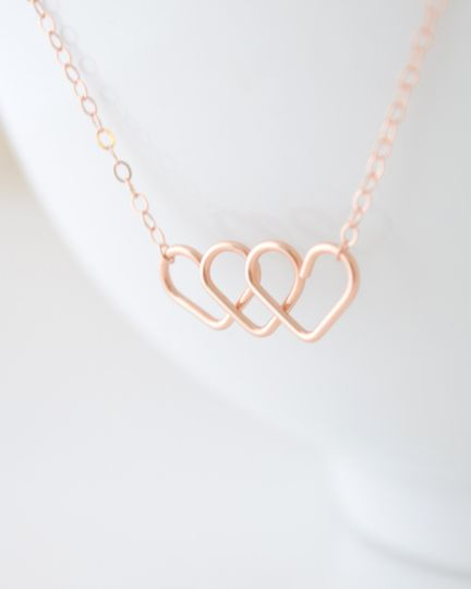 Triple Heart Infinity Necklace. This handmade infinity heart charm is available in gold, silver and...