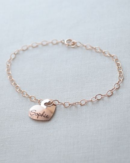 Engraved Name Heart Bracelet. Include a name on the front of this rounded heart charm with tiny...