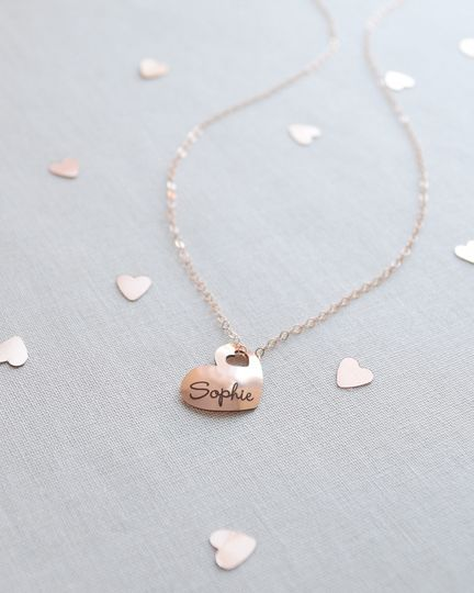Engraved Name Heart Necklace. Include a name on the front of this rounded heart charm with adorable...