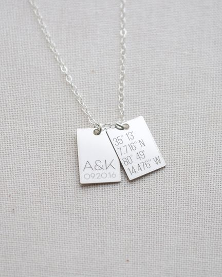 Customize this petite sterling silver tag necklace to remember a special place and time like your...