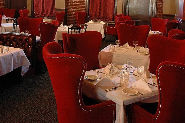 Wilfs trademark red velvet dining chairs are very romantic!