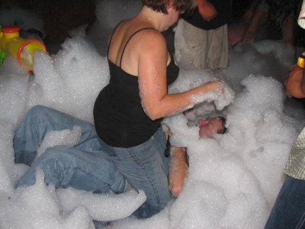 DJ Joe being tackled at his Foam party. Was lots of FUN!!!!