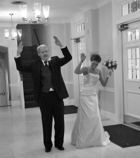 Bride and her Dad breaking the tension before walking up the aisle