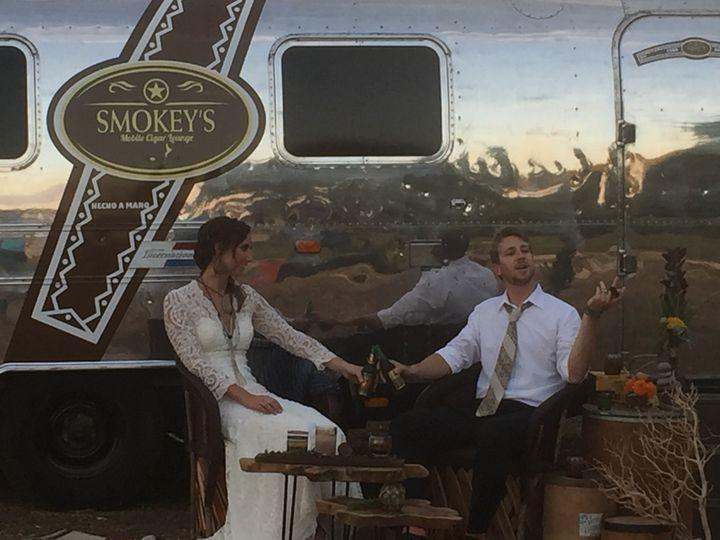 Couple enjoying the cigar lounge