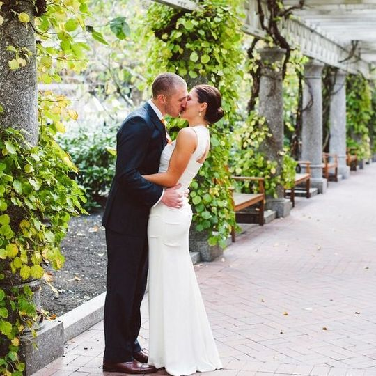 Newlyweds kissing