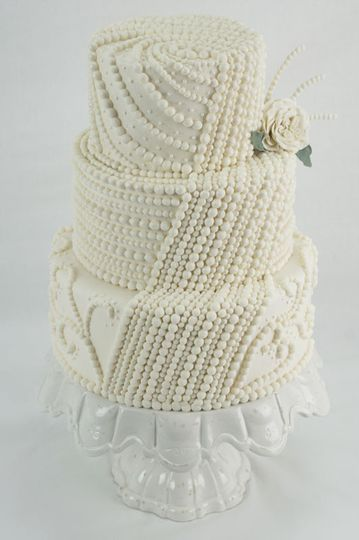 This wedding cake boasts incredible pearl detailing.