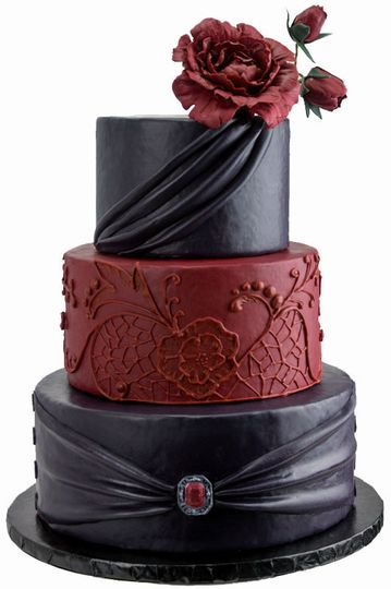 The base layer of this cake features a custom cast, edible jewel. Reproduced from a family pendant,...