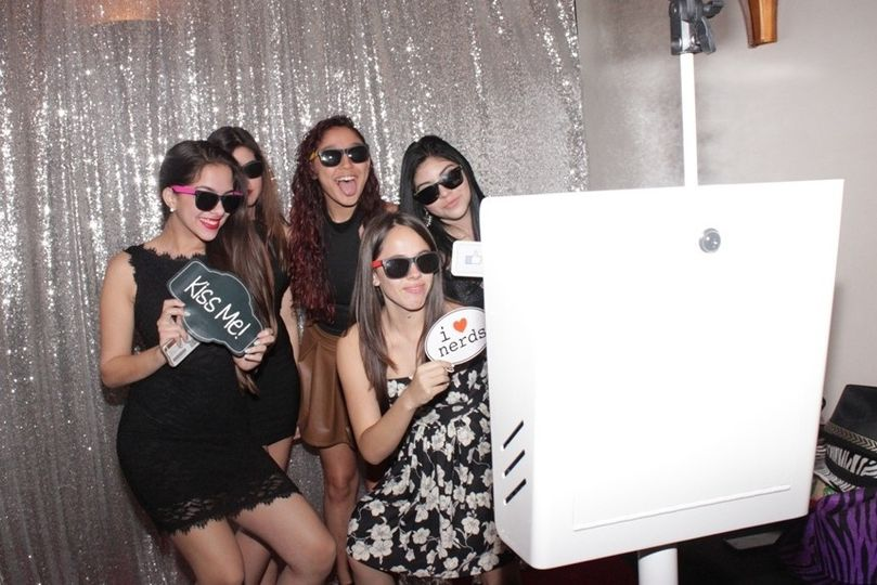 guests using silver photo booth